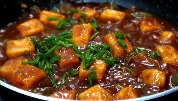 garnish with spring onion or chopped coriander leaves