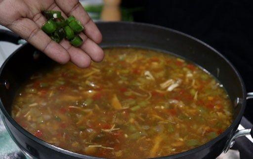 mix-chopped-green-chili-by-hand