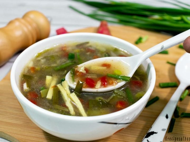 pick-healthy-vegetable-soup-by-spoon-in-white-bowl