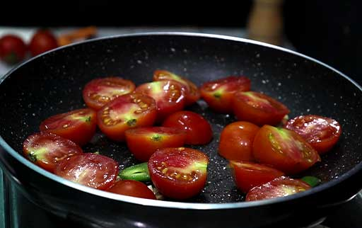 halved-cut-tomatoes-in-pan