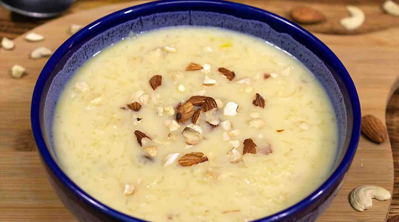 rice-kheer-recipe-sprinkle-with-chopped-dried-fruits-in-blue-ceramics-bowl