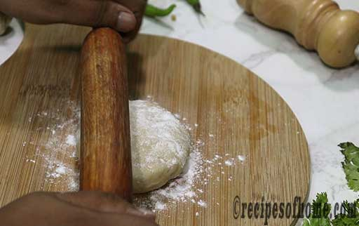 dust flour and spread dough using rolling pin