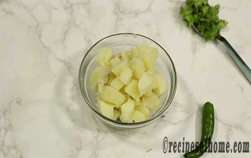 chopped boil potatoes in a glass bowl