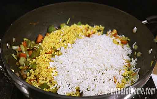 add fried moong dal and soaked rice