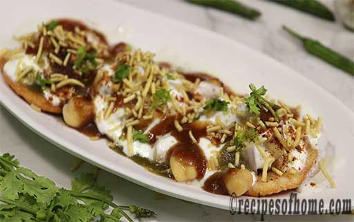 garnish papdi with chopped coriander leaves and sev