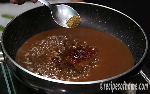 add water,tamarind mixture,spices in a pan