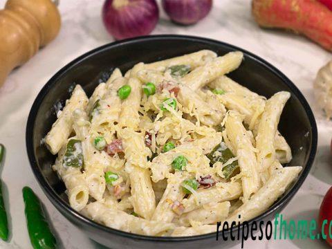 Italian white sauce pasta recipe serve on black bowl garnish with grated chees