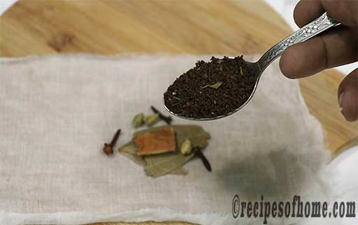 place green cardamom,clove,cinnamon,bay leaf,a few tablespoon of tea leaves in a white cotton cloth